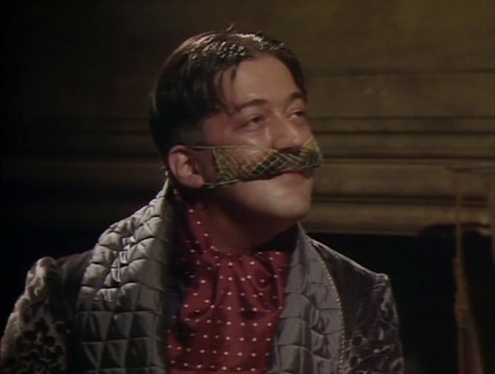 General Melchett wearing a moustache net