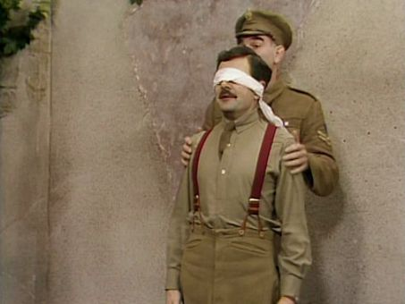 Blackadder wearing a blindfold