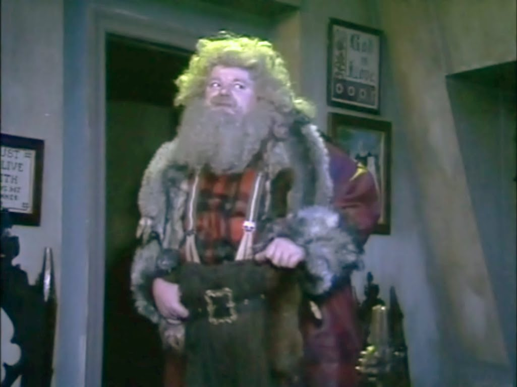 Robbie Coltrane as the Ghost of Christmas in Blackadder